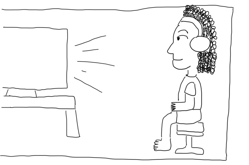 Girl with earphones watching TV